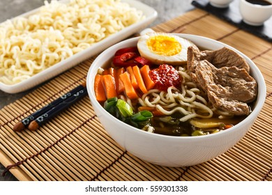 Shoyu ramen noodle soup with veggies, ginger and soy meat.
