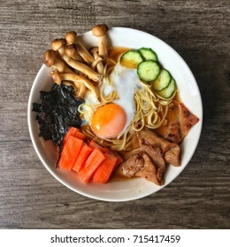 Shoyu Ramen with side dish and soft boil egg home made on wooden plank