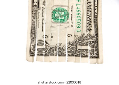 A shredded dollar bill isolated on white.  The image can be used for economic financial inferences.