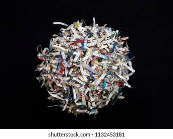 Shredded paper cuttings formed into sphere on black background