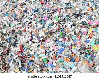 Shredded pieces of plastic in different colors