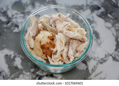 Shredded roast white chicken meat in a glass bowl on a marble counter top. most downloaded chicken meat image