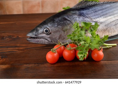 Shredded tuna with parsley and cherry tomatoes on the table