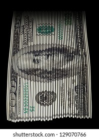 Shredded US hundred dollar bill on black background. Concept for money wasting, money value and savings.
