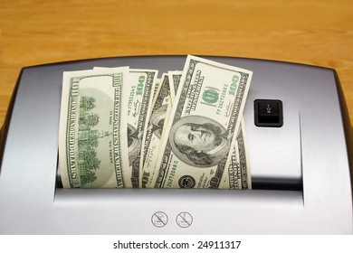 Shredder with heap of dollars (close up)