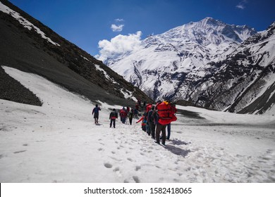 Shree Karka, Nepal - April 25,2019: Hikers are seen walking at Tilicho Base Camp located in Annapurna Circuit
