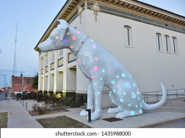Shreveport, LA / USA  9/15/2016  White dog sculpture outside of Shreveport Regional Arts Council