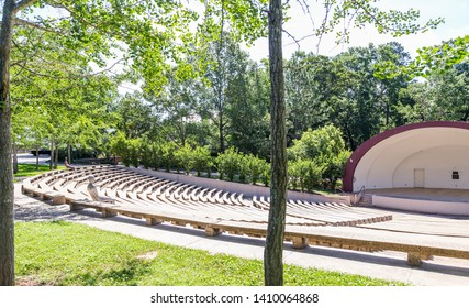 SHREVEPORT, LOUISIANA - MAY 25, 2019: Historic Centenary College Amphitheater:  Historic Centenary College Amphitheater with life size Borders series sculptures periodically seated.