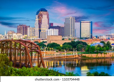 Shreveport, Louisiana, USA skyline over the Red River at dusk.