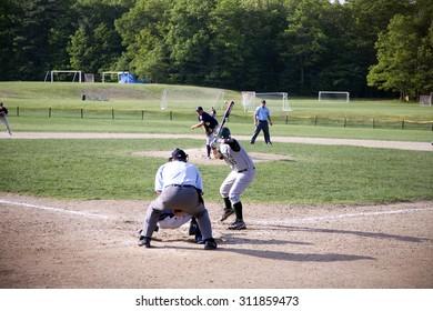 Shrewsbury Colonial high school baseball batter bats against Nashoba Chieftans pitcher, Shrewsbury, MA, 5/27/11
