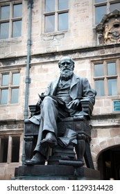 SHREWSBURY, UK - JANUARY 02 2018: Charles Darwin statue in front the Darwin Library