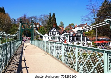 SHREWSBURY, UNITED KINGDOM - APRIL 22, 2015 - Porthill Suspension Bridge across the River Severn with the Boathouse Public House to the rear, Shrewsbury, Shropshire, England, UK, April 22, 2015.