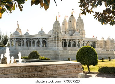 Shri Swaminarayan Mandir Houston. hindu temple landscape in the sunset  .indian   treatises  architecture .sculpted walls