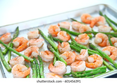 Shrimp and asparagus cook in the oven for a healthy dinner