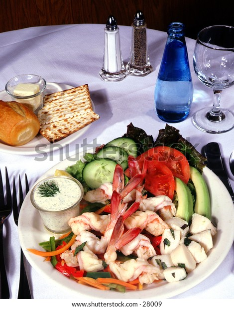 Shrimp and avacado dish on set table