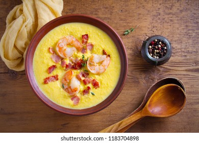 Shrimp, bacon and corn chowder. Creamy corn vegetable soup with shrimps and bacon. overhead, horizontal