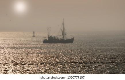 Shrimp Boat during fishing at North Sea,Germany