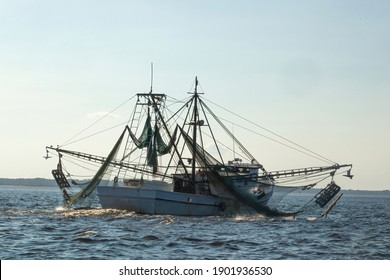 Shrimp boat with nets in the water