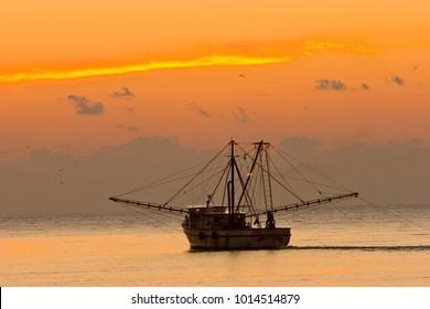 A shrimp boat off St Simons Island, Georgia at sunset.