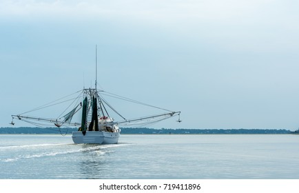 A Shrimp Boat Trawler Heading to Sea for a Day of Fishing in Savannah Georgia