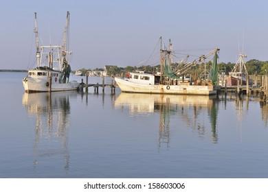 Shrimp boats on the Dickinson Bayou, Galveston, Texas, USA
