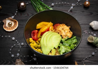 shrimp bowl in a black plate on a dark wooden background