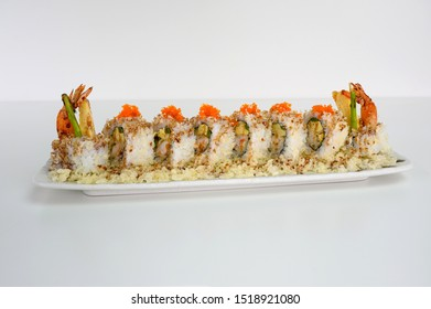 Shrimp breadcrumb filled tamago, cucumber pickle sushi roll with teriyaki sauce on white plate