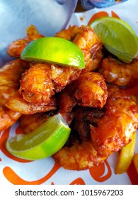 Shrimp in Cajun sauce with lemon and spices.