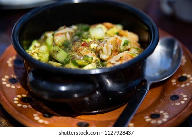 Shrimp Ceviche Aguachile in Pot on Traditional Ceramic Mexican Plate with Spoon
