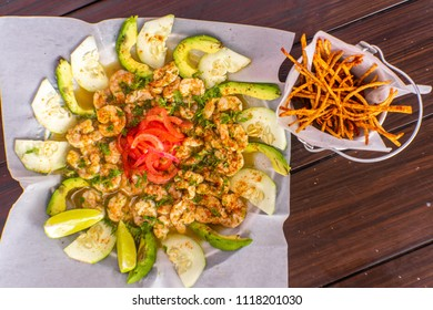 Shrimp ceviche with cucumber and avocado in lemon juice with hot pepper.