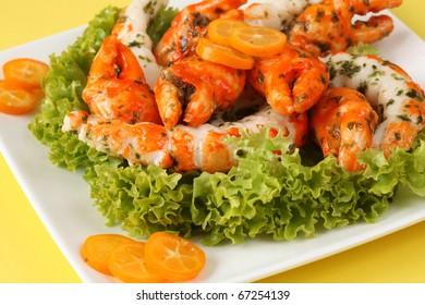 Shrimp and crab shaped surimi sticks with kumquats and lettuce