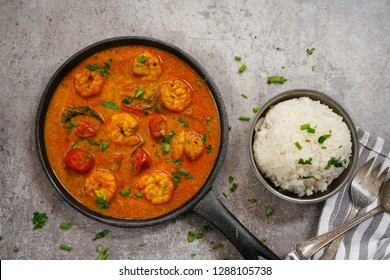 Shrimp in curry coconut sauce with rice in a bowl - Curried prawns,  overhead view