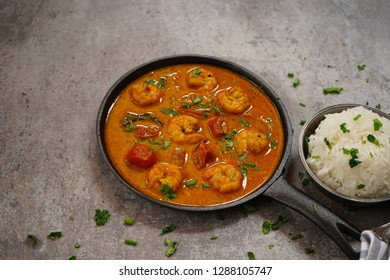 Shrimp in curry coconut sauce with rice in a bowl - Curried Prawns