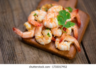 Shrimp delicious seasoning spices on wooden cutting board background / cooked shrimps or prawns , Seafood shelfish