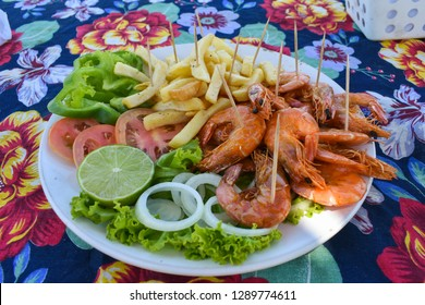 Shrimp dish served at a beach bar on Coroa do Aviao islet, popular destination on the north coast of Pernambuco state (Igarassu, Brazil)