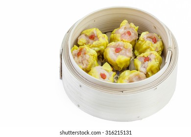 Shrimp dumplings in a bamboo steamer on white background