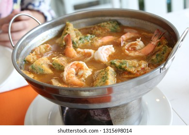 Shrimp and egg sour soup made of tamarind paste with climbing wattle omelette , food in hotpot , thai style traditional (Gang-Som).