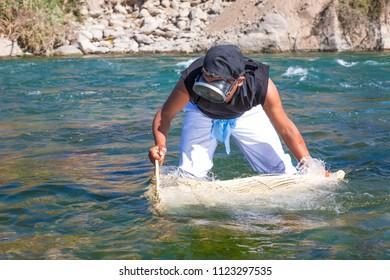 Shrimp fisherman in the river Lunahuana. Cañete August 2014, in Lima Peru.
