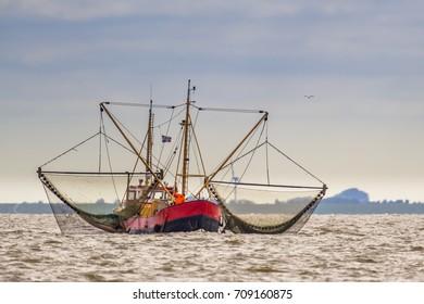 Shrimp fishing cutter ship in the Dutch wadden sea