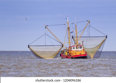 Shrimp fishing cutter vessel in action on the Dutch wadden sea