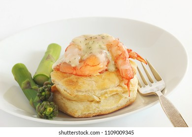 Shrimp gently steamed then gently laid on top of a puff shell and covered in a lemon and dill bechamel sauce