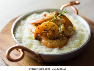 Shrimp and grits with thyme.