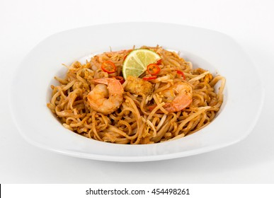 Shrimp Pad Thai noodle closeup over white background