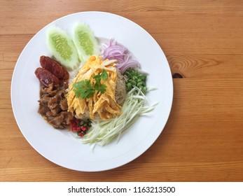 Shrimp paste fried rice (Khao Krook Kapi) on wood background