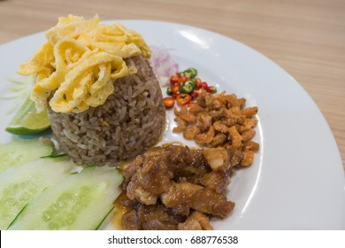 shrimp paste fried rice  on white plate