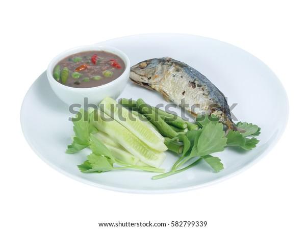 Shrimp paste,mackerel fry,boiled vegetables on a white background