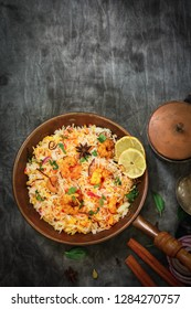 Shrimp (Prawn ) Biryani top down view on wooden background