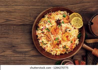 Shrimp (Prawn ) Biryani top down view on wooden background