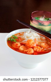 Shrimp or prawn soup is prepared in a savory broth and can be served with rice noodles