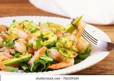 Shrimp salad with avocado and arugula
